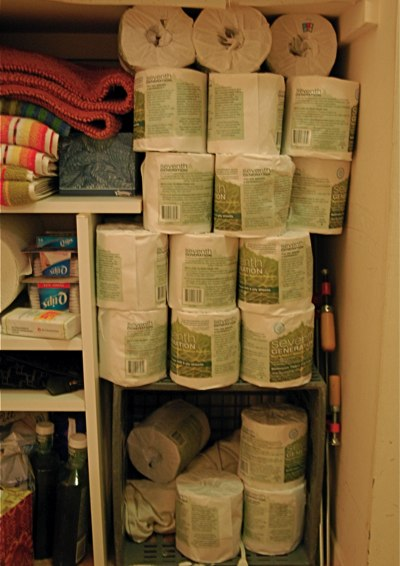 linen closet filled with toilet paper